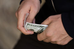 Close up of addict or drug dealer hands with money Stock Photo