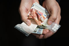 Close up of addict hands with drugs and money Stock Photo