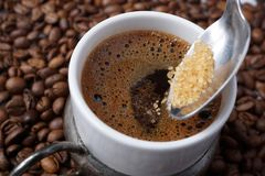 Close up of adding brown sugar in traditional Turkish coffee Royalty Free Stock Image