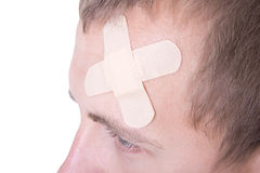 Close up of adhesive plaster on male forehead Royalty Free Stock Photos