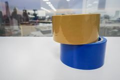 Adhesive tapes on white table Royalty Free Stock Image