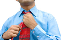 Close-up of  adjusting tie Stock Images
