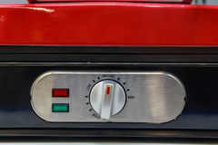 Close up adjustment knob. Closeup red electronic device with rheostat regulator knob and red and green light Royalty Free Stock Photo
