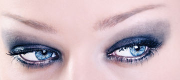 Close Up of Adorable Female Blue Eyes with Black Make Up Royalty Free Stock Images