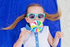 Close up adorable little girl with lollipop on Stock Photography