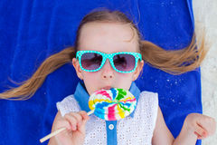 Close up adorable little girl with lollipop on Royalty Free Stock Photography