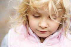 Close up adorable little girl outdoors Stock Photos