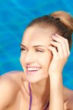Close up of adorable woman in swimming pool Stock Images