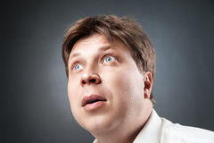 Close-up of adult man looking up in amazement Stock Images