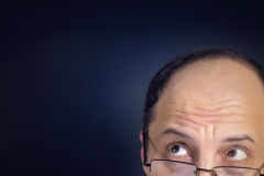 Close up adult man looking up Stock Photography