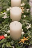 Close up of advent wreath with white candles on christmas stock image