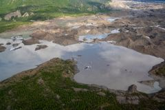 Close up aerial view of moraine, silt of Root Glacier in Wrangell St Elias National Park. In Alaska royalty free stock photos