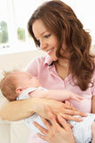 Close Up Of Affectionate Mother Cuddling Baby Boy. At Home Looking Happy Royalty Free Stock Images