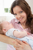 Close Up Of Affectionate Mother Cuddling Baby Boy Royalty Free Stock Photography