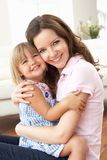 Close Up Of Affectionate Mother And Daughter At Ho. Me Smiling At Camera stock photography