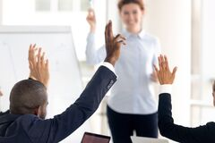 Close up african american businessman raise hand for ask.