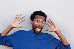 Close up african american with hands raised in shock Royalty Free Stock Photo