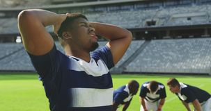 Male rugby player disappointed after losing match in stadium 4k stock video footage