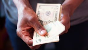 Close up of a african american person counting 10 dollars bills stock video