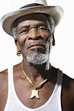 Close-up African American senior man wearing hat over white background Royalty Free Stock Images