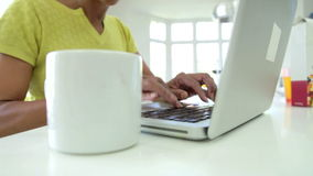 Close Up Of African American Woman Using Laptop At Home Stock Photos
