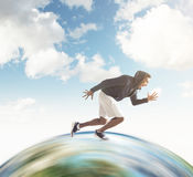 Close up of African guy running on the globe Stock Photography