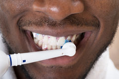 Close-up Of An African Man Cleaning His Teeth Stock Image