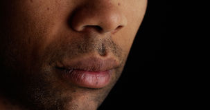 Close up on African man's lips Royalty Free Stock Photo