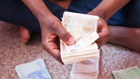 Close up of  african person counting 50 euro bills stock footage