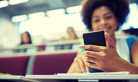 Close up of african student with smartphone royalty free stock photos