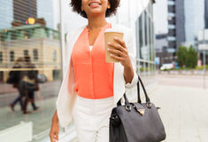 Close up of african woman with coffee in city Stock Photo
