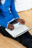 Close up of african woman using laptop Stock Images