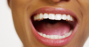Close up of African woman with white teeth smiling Stock Photo