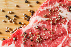 Close up aged beef ribeye with pepper Royalty Free Stock Image