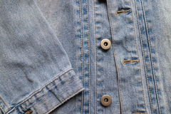 Close up aged denim texture. Old blue jeans jacket with stiched. And vintage bottons Royalty Free Stock Photo