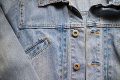 Close up aged denim texture. Old blue jeans jacket with stiched Stock Photo