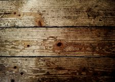 Close up on a aged wood flooring. Horizontal view of wooden planks royalty free stock images