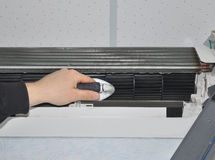 Close up on Air Conditioner Cleaning with Brush Stock Image