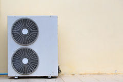 Close up air conditioner heating units installation outside of b Stock Image