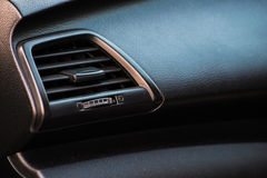 Close up air conditioner panel in modern car. Air conditioner grid panel on car console Royalty Free Stock Images