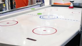Close-up of air hockey table and person`s hand playing with robot. Media. Different working robots collection presented stock footage