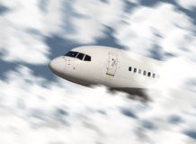 Close up of an airplane's nose flying. Through the clouds Stock Photos
