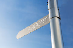 Close up of airport signpost over blue sky Stock Photos