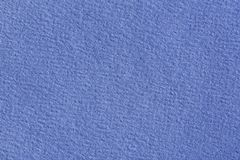 Close up aka macro shot of blue construction paper. stock photography
