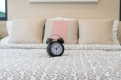 Close up of alarm clock on bed Stock Photos