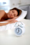 Close-up of alarm clock by bed Stock Image