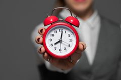 Close-up of alarm clock in a hand royalty free stock photography