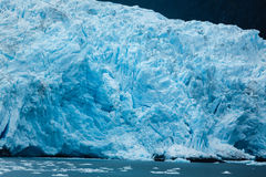 Close-up of Alaskan blue glacier edge and ice dotted ocean Royalty Free Stock Image