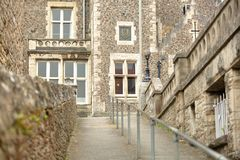 Close-up on an alley leading to the Victorian building Purbeck House Hotel in Swanage Royalty Free Stock Images