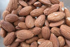 Close up almond in bulk organic food. The almond is a species of tree native to Mediterranean climate regions of the Middle East, from Syria and Turkey to royalty free stock images